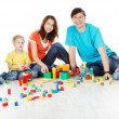 Family playing toys blocks — Stock Photo