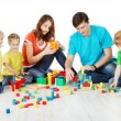 Stock Photo: Happy family. Parents with three kids playing toys blocks
