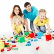 Happy family. Parents with three kids playing toys blocks — Stock Photo #16181735