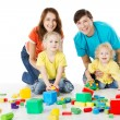Happy family. Parents with three kids playing toys blocks — Stock Photo #16181739