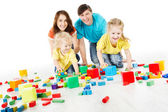 Happy family. Parents with three kids playing toys blocks — Stock Photo