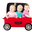 Stock Photo: Group of kids driving in suitcase car