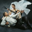 Wedding couple celebrating, singing, drinking and playing guitar — Foto de Stock