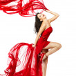 Woman  in red dress dancing with fabric - Foto Stock