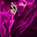 Woman in violet waving silk dress. Dancing. — Stock Photo #21048821
