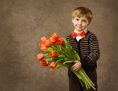 Child holding flowers bouquet. Vintage style. — Stock Photo