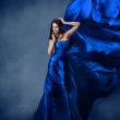Woman in blue dress with flying silk fabric — Stock Photo #25442345
