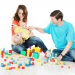 Stock Photo: Happy family. Parents playing with child over white