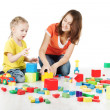 Mother and child playing blocks over white — Stock Photo