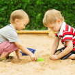 Two kids friends playing with sand outdoor. Summer - spring seas — Stock Photo