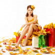 Woman autumn shopping in dress of maple leaves over white — Stock Photo