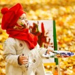 Child drawing on easel in Autumn Park. Creative kids development — Stock Photo