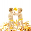 Kids presenting autumn maple leaf as a gift — Stock Photo