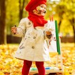 Child drawing on easel in yellow Autumn Park. Creative kid. — Stock Photo