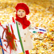 Child drawing on easel in yellow Autumn Park. Creative kid — Stock Photo