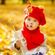 Child drawing on easel in yellow Autumn Park. Creative kids — Stock Photo #30951861
