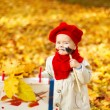 Child drawing on easel in Autumn Park. Creative kids development — Stock Photo #30951863