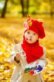 Child drawing on easel in yellow Autumn Park. Creative kids — Stock Photo