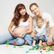 Family playing toys blocks, parents and kid — Stock Photo