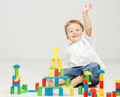 Child playing toys blocks over white — Stock Photo