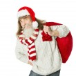 Christmas old man with beard in red hat carrying Santa Claus bag — Stock Photo