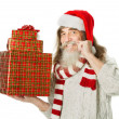 Christmas old man helper with beard in red hat holding gift boxes — Stock Photo
