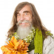Senior old man with beard, long hairs and maple leaves — Stock Photo #32328123