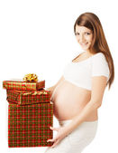 Pregnant woman holding present boxes. — Stock Photo