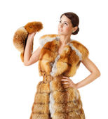 Woman in fur coat, holding fur hat. Isolated white background. — Stock Photo