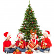 Christmas helpers kids in Santa hat playing under fir tree over white background — Stock Photo #34641763