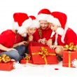 Christmas helpers kids in Santa hat opening presents gift box.  New year presents — Stock Photo