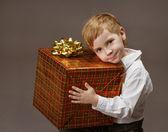Child holding gift box. Boy with big present — Stock Photo