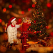 Family decorating Christmas tree. Father and daughter — Stock Photo #36717765