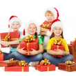 Happy Christmas kids holding presents. Santa helpers with gifts. — Stock fotografie
