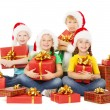 Stock Photo: Happy Christmas kids holding presents. Santa helpers with gifts.