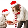 Christmas child with presents and Santa Claus grandfather — Stok fotoğraf