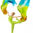 Woman dancing with flutterin flying colorful fabric over white — Stock Photo
