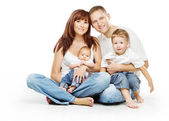 Young family four persons, smiling father mother and two children — Stock Photo