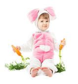 Baby in easter bunny costume with carrot, kid girl sitting rabbit hare — Stock Photo