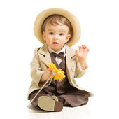 Baby boy well dressed in suit with flower. Vintage children style, white background — Stock Photo