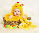 Baby in Easter basket with eggs in chicken costume. Easter holiday concept: nest with baby chick — Stock Photo