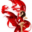 Woman dancing in red dress, fashion model dance whit waving fluttering fabric — Stock Photo #45368207