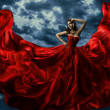 Woman in waving red evening dress — Stock Photo