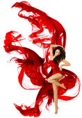 Woman dancing in red dress, fashion model dance whit waving fluttering fabric — Stock Photo
