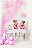 Kids with presents birthday party happy. Girl sisters playing next to gift box — Stock Photo