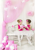 Girl giving children birthday present to sister. Kids and party gift boxes in pink color — Stock Photo