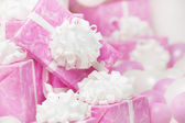 Presents gift boxes, pink background for female or woman birthday — Stok fotoğraf