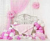 Birthday party room background with gift boxes. Kids celebration presents girl or woman — Stok fotoğraf