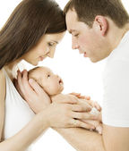 Parents and baby. Family mother, father and newborn kid over white isolated background. New born child birth love concept — Stock Photo