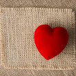 Red heart on burlap, sackcloth background. Valentines Day handmade card — Stock Photo #49338559